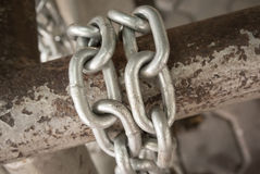 Chain on metal bar Royalty Free Stock Images