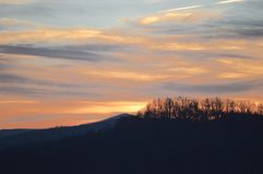 The view of the mountains at sunset stock photos