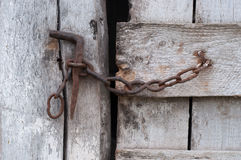 Chain on old wooden door Stock Photos