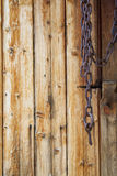 Chain on Old Wooden Planks Background Texture Royalty Free Stock Images