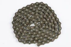 Chain ordnat för cykel på en vit tabell Periodiskt serva av delen fotografering för bildbyråer