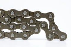 Chain ordnat för cykel på en vit tabell Periodiskt serva av delen royaltyfria bilder