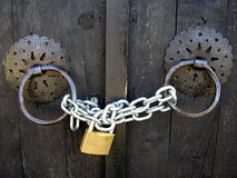 Chain with padlock. Door locked with chain and podlock Royalty Free Stock Photo