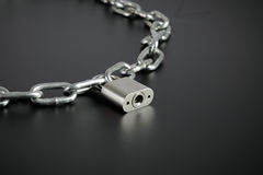 Chain and padlock Stock Images