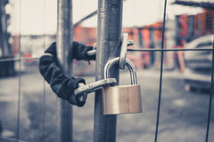 Chain and padlock on gate at construction site. Lock on closed fence stock photo