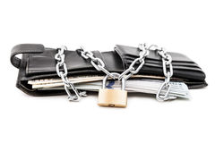 Chain padlock on leather wallet full of dollar currency money. Business safety and finance protection concept - metal chain link with locked padlock on leather Stock Photo