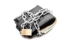 Chain padlock on leather wallet full of dollar currency money. Business safety and finance protection concept - metal chain link with locked padlock on leather Stock Photography