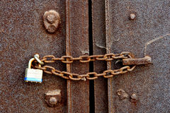 Chain and Padlock on Old Steel Door royalty free stock photography