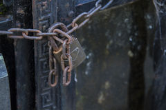 Chain with padlock securing doors Stock Photography