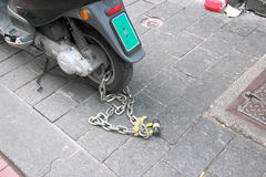 Chain and padlock security wheel motorcycle Stock Image