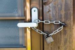 Chain and Padlock on Steel Door Stock Image