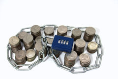 Chain and Padlock on Top of Large Numberof Coins Stock Image
