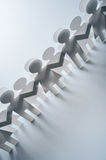 Chain of paper people. Chain of paper cutout people Royalty Free Stock Photography