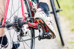 Chain, pedal, rear wheel and sprocket of bike. Detail, man having foot on pedal Stock Photography