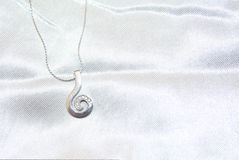 The chain and pendant are white gold with diamonds. On a white background royalty free stock photography