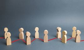 Chain of people figurines connected by red lines. Cooperation and interaction between people and employees. Dissemination. Of information in society, rumors royalty free stock photography