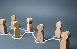 Chain of people figurines connected by white lines. Cooperation and interaction between people and employees. Dissemination of information in society, rumors stock photos