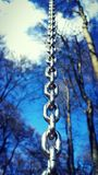 Sky chain. Photo of a chain on a blue sky backround Stock Image