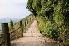 Chain rail and stone balusters along mountainside path in aftern Royalty Free Stock Photos