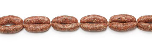 Chain of raw sausages. Isolated on white background Royalty Free Stock Images
