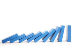 Chain reaction. Dominoes falling is chain reaction Stock Photography