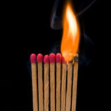 Chain reaction. Matches burning in a chain reaction Royalty Free Stock Image