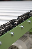 Chain of roller conveyor - Shallow DOF Royalty Free Stock Photography