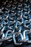 Chain row - color. Textured image of silver chains on black stock photos