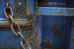 Chain on rusted metal Royalty Free Stock Photo