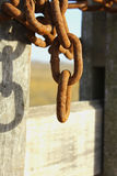 Chain. Rusty chain and lock,Oxid chains on the field Royalty Free Stock Photos