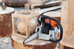 Chain saw. And products from a tree Royalty Free Stock Photography