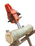 Chain saw in cut of wooden log Stock Photography
