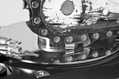 Chain saw and hard drive Royalty Free Stock Image