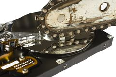 Chain saw and hard drive Royalty Free Stock Photos