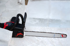 Chain saw and ice Royalty Free Stock Photos