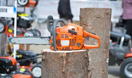 Chain saw on log Stock Photo