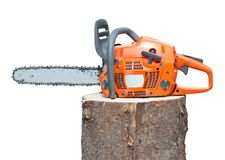 Chain saw on log Stock Images