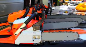 Chain saw machines row perspective in market Royalty Free Stock Photos