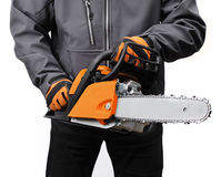 Chain saw in male workers hands Royalty Free Stock Image