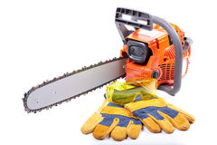 Chain saw and protective clothes. Royalty Free Stock Photos