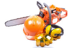 Chain saw and protective clothes. Royalty Free Stock Images
