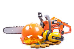 Chain saw and protective clothes. Stock Image
