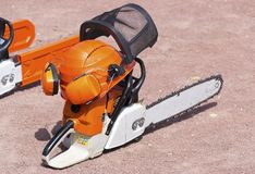 Chain saw/. Chain saw and protective equipment for work Royalty Free Stock Image