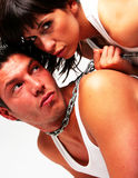 Chain steel couple. Guy with dominant girl conjoint with steel chain in underwear celbrating the shotgun wedding Stock Photos