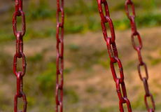 Chain stock photo. Beautiful red coloured chains with natural background photograph stock photography