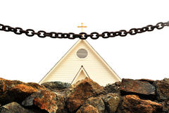 Chain and stone wall in front of church Stock Image