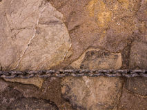 Chain on stonewall Stock Image