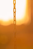Chain at sunset. Metal chain hanging at sunset Royalty Free Stock Image