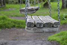 Chain Swing. And green grass in autumn park Stock Photos