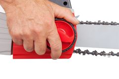 Chain tension on the electric saw Royalty Free Stock Photos